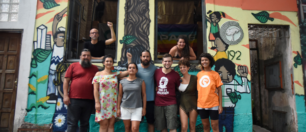Group photo of Friends of the Earth Brazil in front of the Casanat social centre
